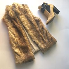 Zara fawn brown collared faux fur vest This is a Zara girls item for sale, I am a size small and this will fit a xs or petite small.  Fawn brown faux fur (beautifully dyed does not look cheap) gold zip with leather detail.  Collar looks great layered under a leather jacket or coat.  Some pilling on lining around edges and some wear on fur shown in last picture under arm area. 2nd to last picture shows stain on lining, none on exterior Zara Jackets & Coats Vests