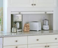 An appliance garage is a perfect way to hide the clutter.