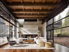 a travertine marble slab fireplace anchors the space; the floors are ca walnut