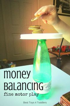 Easy game for toddlers and preschoolers to work on fine motor skills and patience - money balancing! You can use real or play coins!
