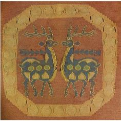 This coat is a tapestry (or kilim) wool coat, lined with silk. It is the 9th or 10th century, with birds and gazelles in roundels.