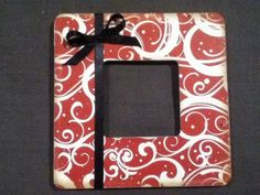 decoupage wood frame, used scrapbook paper, gel medium, a ribbon....easy cute gift or decor for your home
