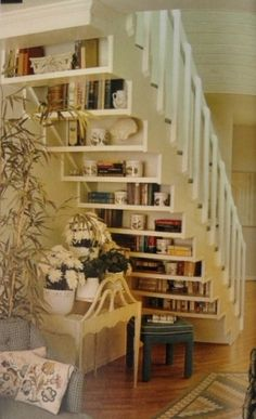 """interior"" shelving under the stairs - very interesting use of the space if you want to put a seating area too!"