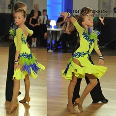 Junior 1 Latin Dancing Dress with shipping. DSI fabrics. Sample SALE. Danced only in 1 competition, perfect condition. The girl on the photo is 142,5 cm tall. Main measurements are: bust 66cm waist 59,5cm hips 72cm IF YOU NEED JUNIOR DRESS OR SET, WE CAN DO SOMETHING SIMILAR (OR