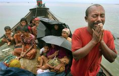 A Rohingya Muslim man who fled Myanmar to Bangladesh to escape religious violence cries as he pleads from a boat after he and others were intercepted by Bangladeshi border authorities in Taknaf, Bangladesh