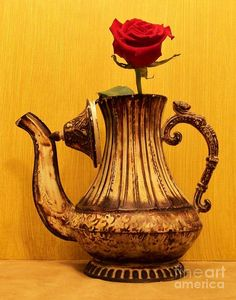 Antique teapot as vase