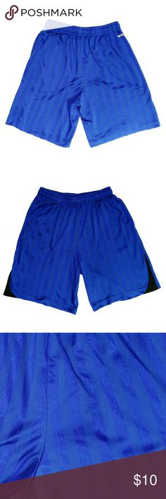 Athletic Workout Blue Striped Shorts Size small Athletic workout running/soccer shorts. Alternate blue vertical stripes. Contrast black design on the legs. Side seam pockets. Elasticized waistband with hidden ties. Approximate measurements of the shorts are Inseam 9 inches and Outseam 18 inches. There are pulls on the fabric. Overall, the shorts are in good condition. Nike Shorts