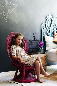 Chalkboard and pretty fuchsia peacock chair in a girl's room