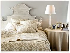 love the headboard and pattern on the comforter and pillows.