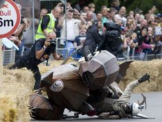 A team crashes into hay bales in the Red Bull Soapbox race in London. The Red Bull Soapbox race is an annual event in which amateur drivers race with their homemade soapbox vehicles down a hill through obstacles.  Justin Tallis, AFP/Getty Images