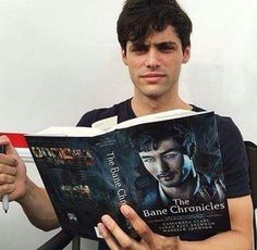 Alec is reading about his boyfriend