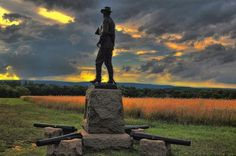 Brigadier General John Buford's Monument at Gettysburg by Dave Sandt -The bronze statue was created in 1895 by sculptor James Kelly, who was well known for his statues of military figures. The cannon surrounding the monument are the actual pieces of Calef's Battery, 2nd United States Artillery, Battery A. The barrel facing down Chambersburg Pike fired the first Union artillery shot of the battle under General Buford's personal direction. Captain Calef tracked it down after the war using...