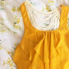F21 Yellow ruffled sleeveless blouse! Forever 21 dark yellow ruffled tank top. White crocheted back. Worn ONCE! Forever 21 Tops Blouses