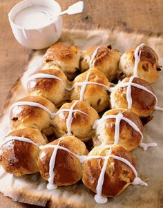 England's Hot Cross Buns are marked with sweet icing. Recipe: Hot Cross Buns   - CountryLiving.com