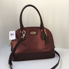 New authentic Coach satchel metallic cherry Crossgrain leather Inside zip pocket Zip-closure, fabric lining Handles with 4 3/4 drop Longer, detachable strap with 21 1/2 drop for shoulder or crossbody wear 12 1/2 (L) x 9 (H) x 5 1/2 (W) #SYE Coach Bags Satchels