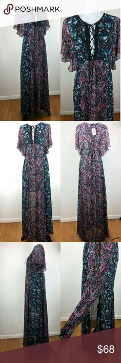 🎉HP🎉 Guess Gorgeous Boho Maxi Dress This dress is beautiful, my photos don't do it justice. Guess boho inspired Maxi dress with lace up neckline, butterfly sleeves and two front slits making it an ideal choice for day or night.   It is sheer with a short black slip beneath it. 100% polyester.   I bought this dress today at big Guess store labor day sale and tags were cut to prevent returns. But it is brand new with tags. Guess Dresses Maxi