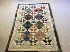 Basket quilt made by Sharon Theriault from Thimbleberries scraps