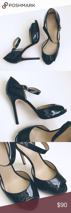 Saks Fifth Avenue heels. Black heels with strap and buckle closure, worn once. Leather sole. Saks Fifth Avenue Shoes