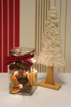 Christmas Storage Jar. Made with cones, dried orange slices and LED Christmas lights.