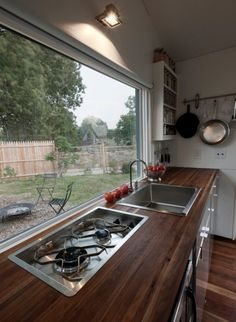 ...that flips over to reveal a stove top! The kitchen also has a foot pedal which operates the faucet for better sanitation, water conservation, and convenience!