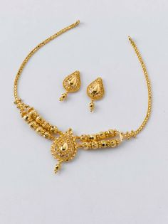 Necklace - 12.200 gm, Rs 42,200 /- Earrings - 1.900 gm, Rs 6,650/-