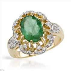 $909.00  Superb Brand New Ring With 3.00ctw Precious Stones - Genuine  Diamonds and Emerald Made in 14K Two tone Gold. Total item weight 6.0g - Size 7.5 - Certificate Available.