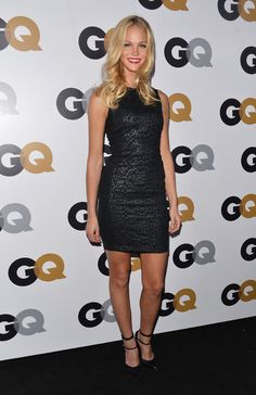 High necklines were all the rage at the GQ Men of the Year party in Los Angeles—and Victoria's Secret Angel Erin Heatherton looked great in the trend. Her high-neck sleeveless black dress is body-conscious and sexy without giving anything away.