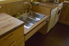 A dropped sink without a cabinet below is a great design for your #aginginplace kitchen #qca