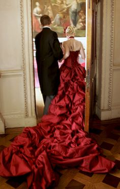 Sort of feeling the idea of a RED wedding dress! Something about it is so dramtic and romantic and eye catching...I think I could pull it off. Hmm...
