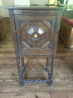 Antique, possibly late 19th century, chest with spindle legs, original hardware and stunning star burst pattern center relief possibly bone.
