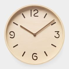 Bi-Color Plywood Clock: This easy-to-read wall clock is made of plywood and glass. The natural wood face has die-cut numbers and index marks, and hands in a contrasting darker wood. One AA battery included.   http://www.momastore.org/museum/moma/ProductDisplay_Bi-Color%20Plywood%20Clock_10451_10001_112074_-1_26663_11551_112132