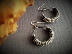 Items similar to Black and Grey mixed media dangle earrings with sterling silver hooks, Half circle, Yarn wrapped, Striped winter earrings, Tribal inspired on Etsy Half Circle, Metal Beads, Silver Color, Hooks, Dangle Earrings, Black And Grey, Dangles, Mixed Media, Jewels