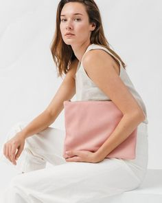 The chicest flat leather pouch in the softest leather by Baggu. Big enough to luxuriously hold letter sized documents, a notebook, or an iPad Air. Fully lined.