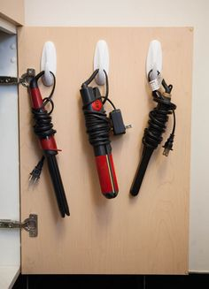 You can use hooks inside of a cabinet door for lots of things! Putting your hair tools there is just one of the many ideas. When you put them inside a drawer, they always get too messy, and this way everything looks neat!