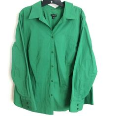 Talbots Woman Classic Green Stretch Button Up 20 This Talbots Woman Classic Green Stretch Button Up Shirt is a Plus size 20 in great used condition. No pilling. You need this in March!! 98% cotton, 2% spandex fabric with flattering bust darts & reinforced elbows. Bust measures 24.5 inches across laying flat, measured from pit to pit, so 49 inches around. 28 inches long. ::: Bundle 3+ items from my closet and save 30% off when you use the app's Bundle feature! ::: No trades. Talbots Tops…
