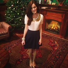 Silver and Gold decorations on every girl and Christmas tree. {Love her outfit}