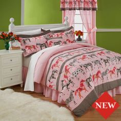 Girl's Pony Bedding | Horse-crazy girls will love this pony-riffic kids' bedding, featuring a parade of horses in shades of pink and brown. Polka dot and floral accents add a pretty touch to the bedding, making the Mustang Sally comforter set perfect for any little girl's bedroom from tot to teen.