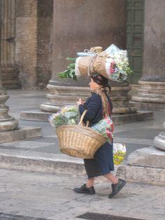 flower seller in Rome - could be painted Flora Flowers, Fruit Flowers, Street Vendor, Hindu Deities, Flower Garlands, Human Condition, Flower Ideas, Pinwheels, Old Women