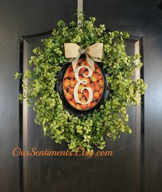 Fall Wreath Pumpkins Boxwood Wreath, Wreath for door, Door Wreaths, Floral Door Wreath, Oval Frame Boxwood Door Wreath  This wreath is composed of a solid circular sturdyboxwood base with artificial evergreen boxwood surrounding an oval brown/black frame. The background is fabric and we have a selection to choose from; photo 4. Your monogram will be painted white or black according to the most suitable for the background fabric selected. If you would prefer one color over the other, just…