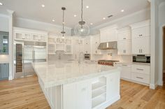 Gorgeous new kitchen and large island filled with storage space.