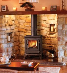 Is there anything cosier than an exposed brick fireplace. Complete with a Broseley York Midi SE Multi Fuel Stove Wood Stove Surround, Wood Stove Hearth, Wood Burner Fireplace, Fireplace Hearth, Home Fireplace, Fireplace Design, Exposed Brick Fireplaces, Inglenook Fireplace, Modern Fireplaces
