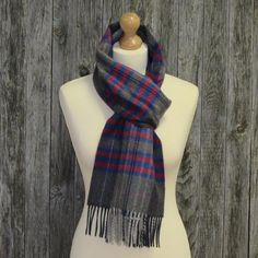 Color: Dark grey paid with red, royal blue and pink. Long stylish scarf