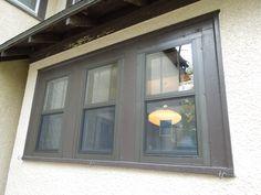 Larson flush mount double hung storm window, Earth tone brown color.
