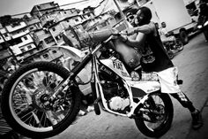 Motorcycle stunts in Caracas. Motorcycles, like cellphones, are some of the most coveted objects in the city, and are the source of a number of conflicts.    Read more: http://lightbox.time.com/2012/10/04/the-street-gangs-of-caracas/#ixzz28qOc813M