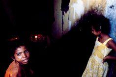 Alex Webb - DOMINICAN REPUBLIC. Santo Domingo. 1980. Living under the bridge that crosses the Ozama River