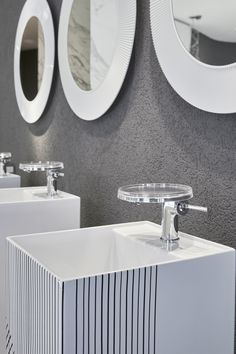Kartell by Laufen Flagshipstore brought its innovative and functional vision of the bathroom to Milan Design Week 2017_NEW skin decors on freestanding washbasin all saint mirror NEW colour white
