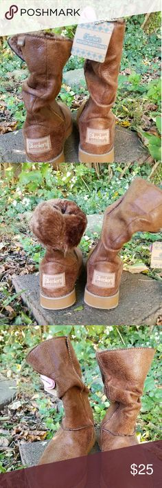 Brown sketches memory foam,water resistant boots NWOT Size 5.5 Brown sketches boots never been worn. They are water resistant and have memory foam. They are in new condition and would be a great addition to your Fall wardrobe. sketchers Shoes