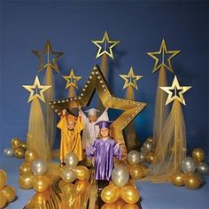 Let your little grads shine on their big day with this Shining Stars Complete Theme. It includes 1 - Gold Star Arch Kit 1 - Tall Shining Star Stands Kit (set of 1 - Short Shining Star Stands Kit (set of 1 - Super Star Pathway and Balloons Kit. 5th Grade Graduation, Graduation Theme, Kindergarten Graduation, Graduation Decorations, School Decorations, Balloon Decorations, Christmas Decorations, Holiday Decor, Graduation Ideas