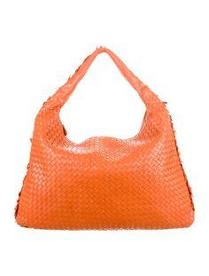 Orange intrecciato leather Bottega Veneta Maxi Veneta hobo with suede lining, single pocket at interior wall with zip closure and zip closure at top. Shop authentic designer handbags by Bottega Veneta at The RealReal.