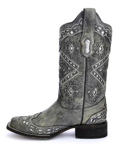 Be a stylishly dressed cowgirl by adorning these gorgeous women's Corral square toe black Western boots! Handcrafted from distressed leather for that appealing worn-in look, these square-toe boots showcase glittered cutout inlay details on the shafts & feet. They also feature pull straps to help for easier dressing, cushioned insoles and leather linings provide much comfort, and leather outsoles that have rubber inserts make for confident strides.